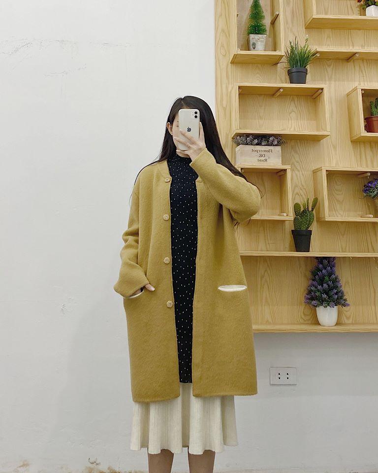 Áo khoác nữ dáng dài – item không thể thiếu của các cô nàng sành điệu